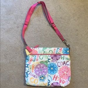 Coach purse with playful flower pattern